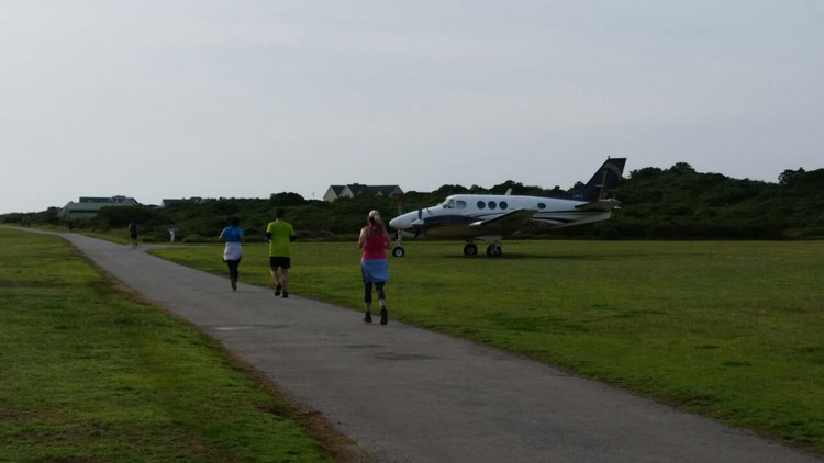 Maybe a flight home would be quicker - trail runners run through Air Park, St Francis