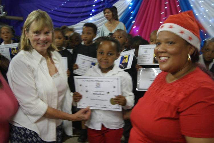 2017 Learner of the Year Mivuyo Zono with trustee Judy Slade and teacher Roseline Goeda