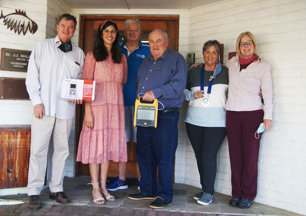 Rotarians donate a defibrilator to St Francis community